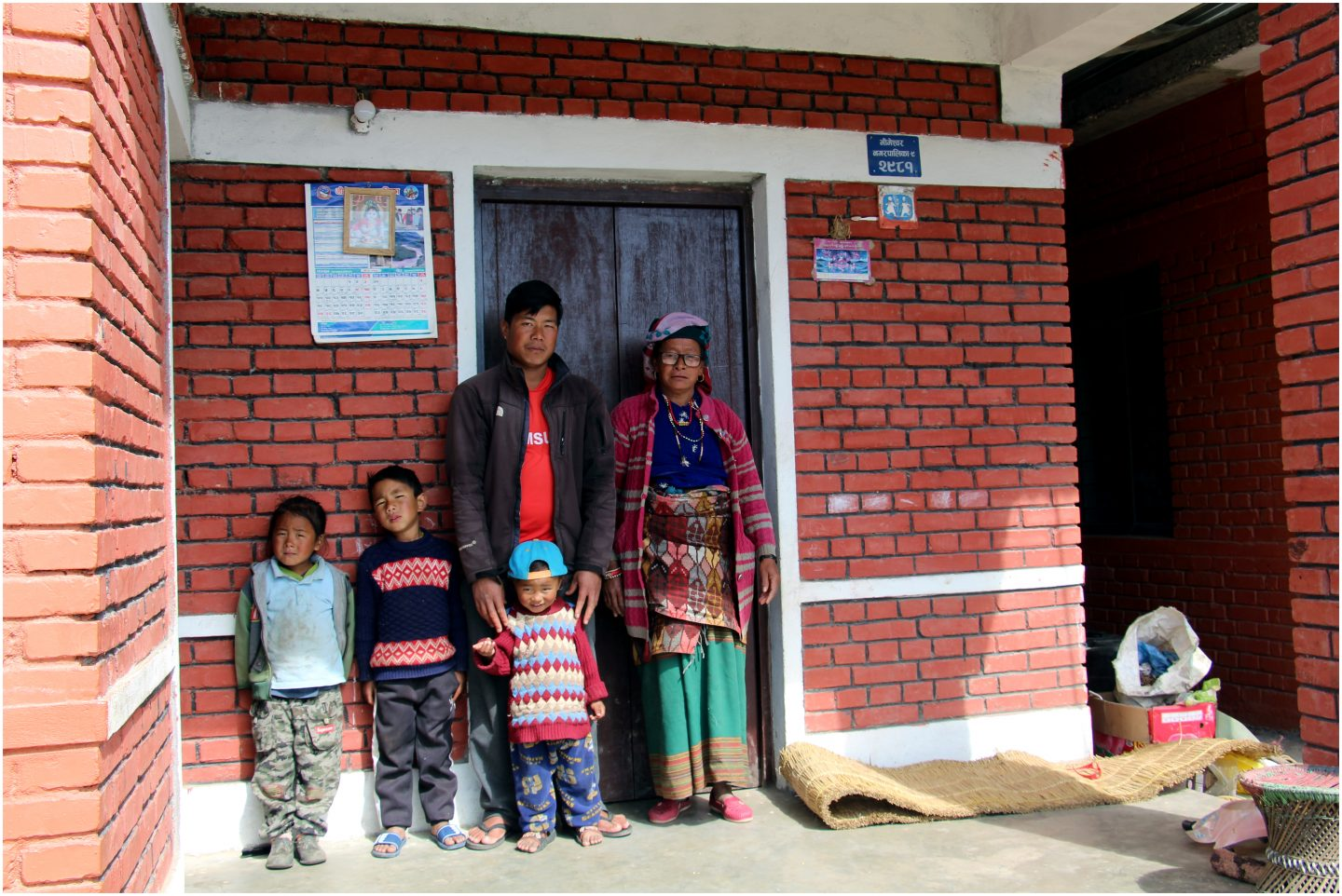 Nepal-ERP-Dolakha-Dorje Tamang with some family outside his house-1